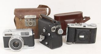Three mid 20th Century vintage cameras including Baldas Yashica ET - Matic and A Pathe Scope