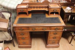 A Victorian walnut twin pedestal desk, the upper section with two small drawers and a gallery