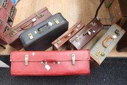 A collection of five various vintage suitcases and a leather briefcase, graduating sizes (6)