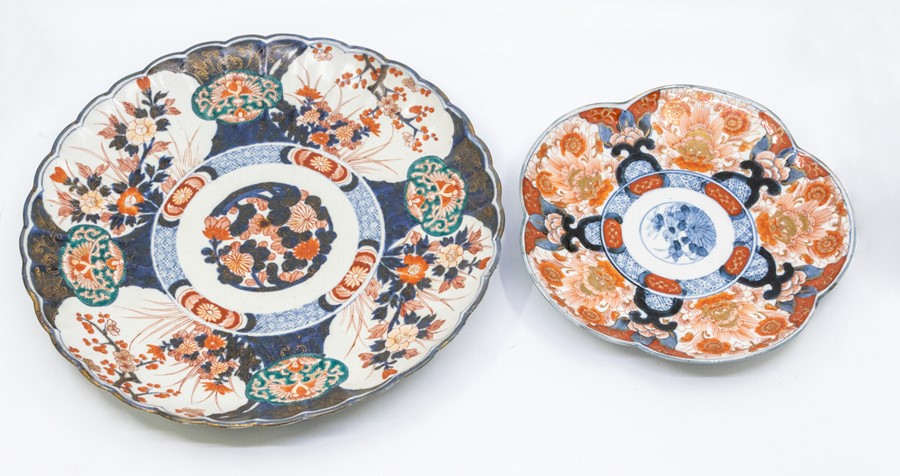 A Chinese Imari circular charger, scallop edge, painted with prunus, flowers and motifs. 32cm diam