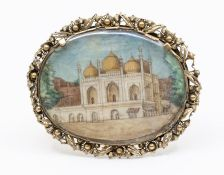 A fine large 19th century Indian gold backed brooch, oval in form with a decorative filigree and