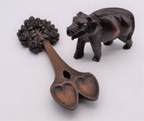Chinese hardwood elephant missing trunk and ivory tusks along with a hand carved fold art lovers