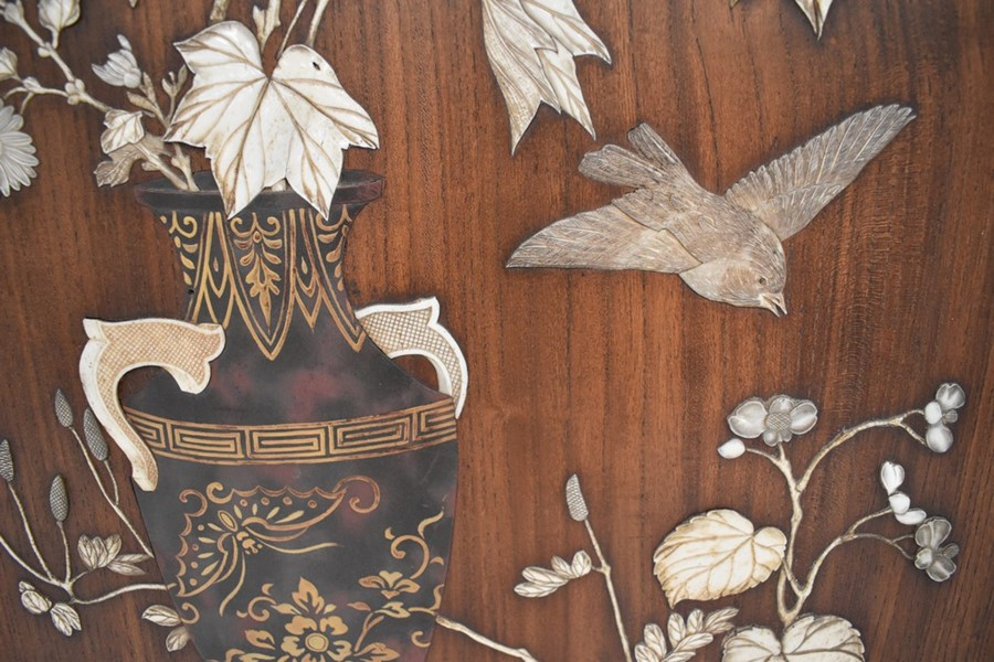 A Japanese panel inset with raised decoration depicting vase of flowers on table with bird, - Image 2 of 5