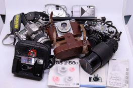 A collection of cameras to include vintage Series1, 70-210 zoom with Macro, Nikon F55 SLR, Canon