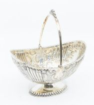 A late Victorian silver boat shaped sugar basket, chased fluted, floral and geometric decoration,