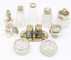 A quantity of silver mounted cut glass condiment bottles, various dates and makers (Q)