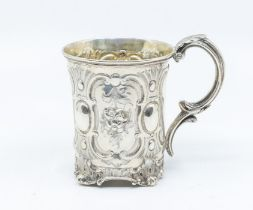 A Victorian parcel gilt mug, the body chased with panels of flowers, oval between, on scroll