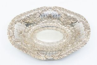 An Edwardian large lozenge shaped silver serving / cake dish, profusely chased and repousse with