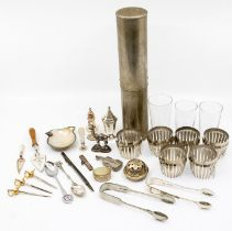 A collection of silver to include: pepper pot, caster top, trowel shaped page marker, toothpick