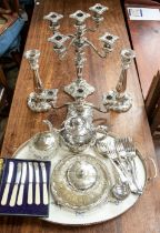 A collection of plated items to include candlesticks, large tray, candelabra, butter dish, teapot