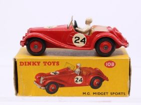 Dinky: A boxed Dinky Toys, M.G. Midget Sports, 108, red body with tan interior, #24, original box,