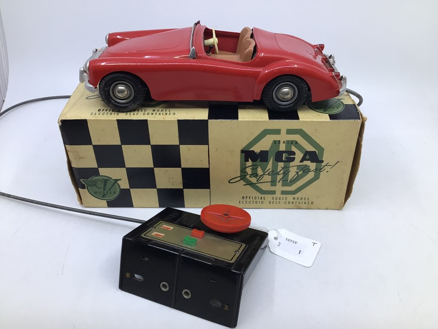 Victory: A boxed Victory Industries, Surrey, remote control, battery operated, MGA, red with tan