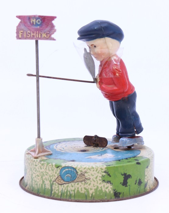 Mettoy: An unboxed Mettoy tinplate 'Billy the Fisherman' clockwork toy. Tin printed base,with a