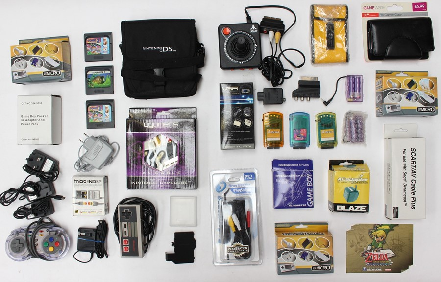 Video Games: A collection of assorted video game accessories to include: cables, adaptors,