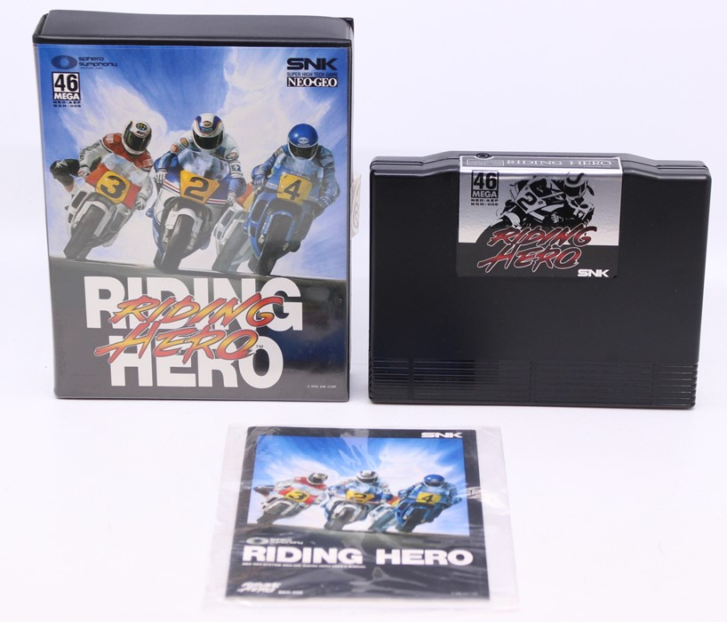 Neo Geo: A cased Neo Geo AES, Riding Hero, Game Cartridge, original case and bagged instructions.