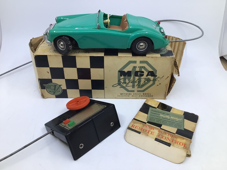 Victory: A boxed Victory Industries, Surrey, remote control, battery operated, MGA, green with tan