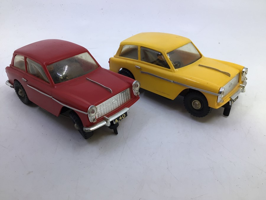 VIP Model Roadways: A pair of unboxed VIP Model Roadways, Austin A40 vehicles, one in red, the other