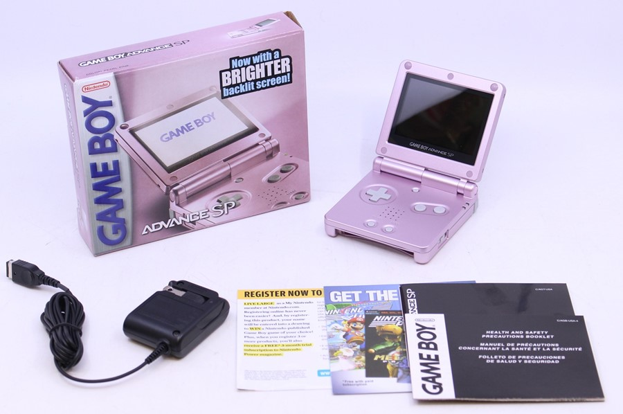 Game Boy: A boxed Nintendo Game Boy Advance SP AGS-101, Pearl Pink, US Version, unused, with