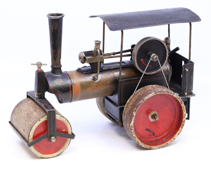 """Live Steam: An early 20th century, live steam, D.C., Germany, steam roller, flywheel approx. 2.5"""","""