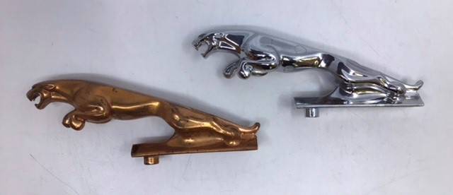 Jaguar: Two Jaguar Leaping Cat mascots, one chrome and one unusual copper plated. Both have serial