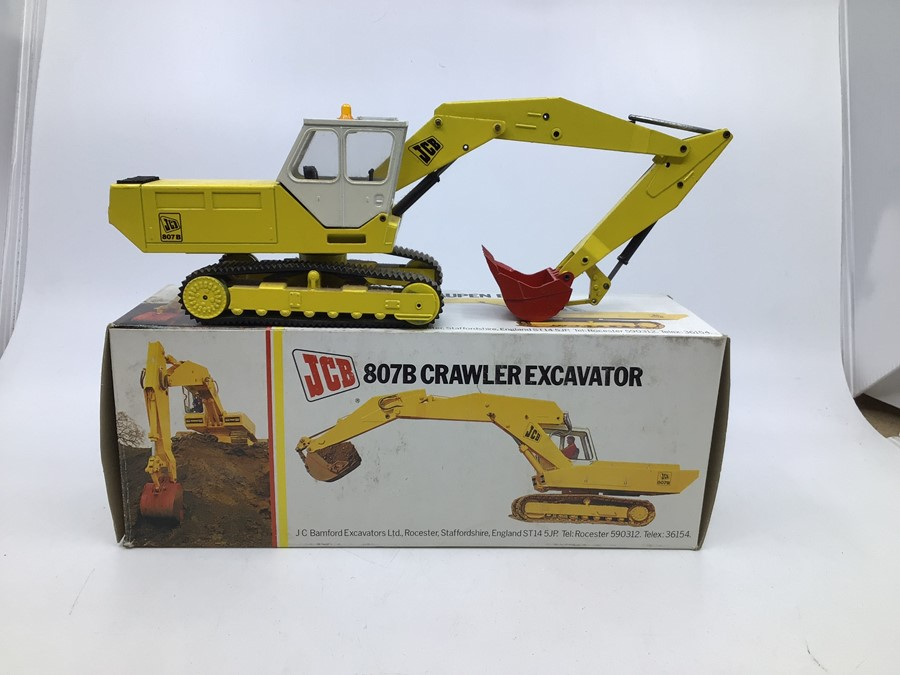 JCB: A collection of assorted JCB diecast models by NZG: 3C Mk III Excavator Loader, display dust - Image 2 of 3