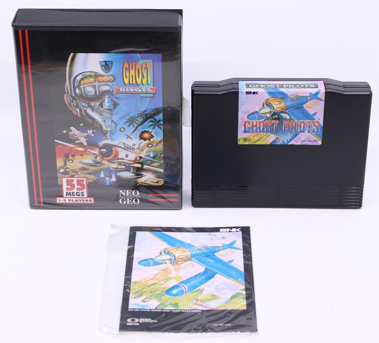 Neo Geo: A cased Neo Geo AES, Ghost Pilots, Game Cartridge, original case and bagged instructions.