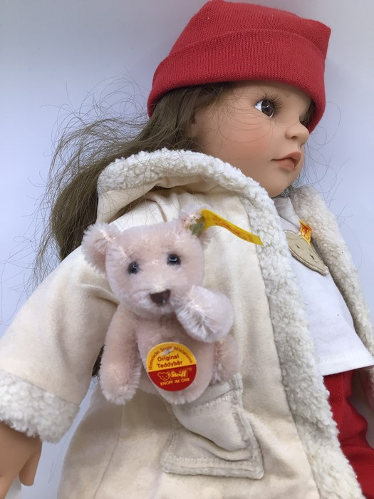 Gotz: A Gotz girl doll, with red hat, white shirt and red trousers, complete with small Steiff - Image 2 of 3