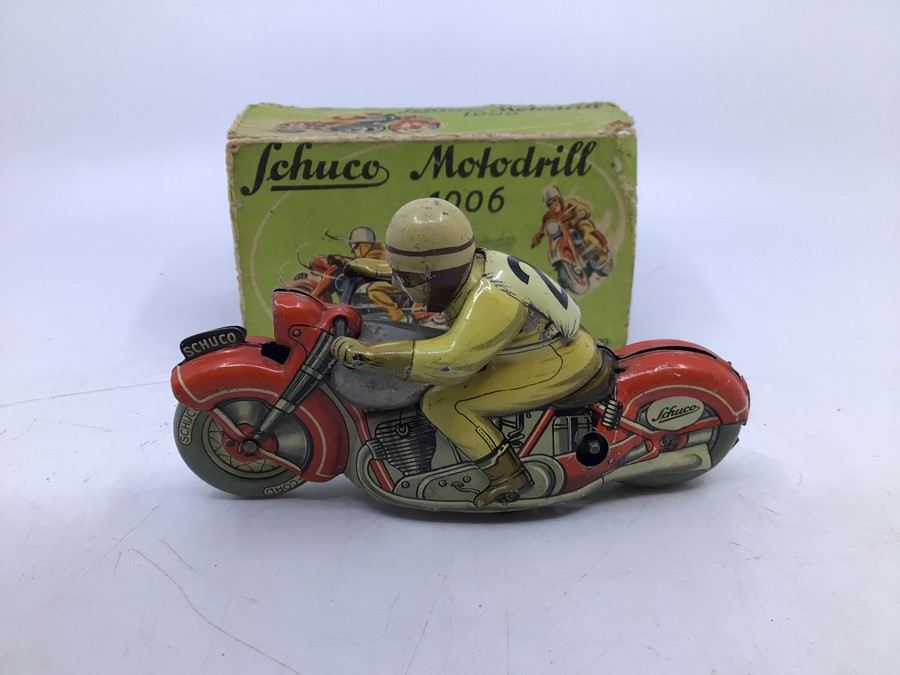 Schuco: A boxed Schuco Motodrill 1006 tinplate clockwork motorcycle. Good condition but missing