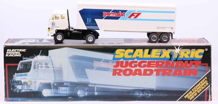 Scalextric: A boxed Scalextric, Juggernaut Roadtrain, C335 Parmalat Roadtrain, in original box,