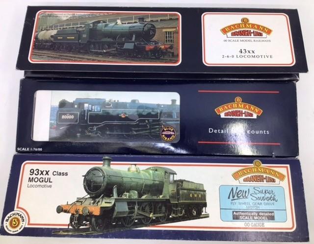 Railway: three 00 gauge Bachmann locomotives: 32-353 Standard class 4MT Tank repainted, 31-826