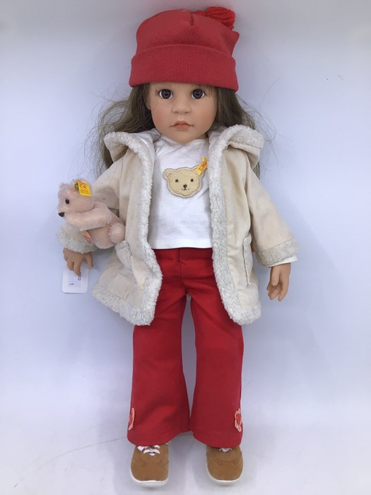 Gotz: A Gotz girl doll, with red hat, white shirt and red trousers, complete with small Steiff