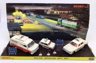 Dinky: A boxed Dinky Toys Police Vehicles Gift Set 297. Complete apart from one cone. Some