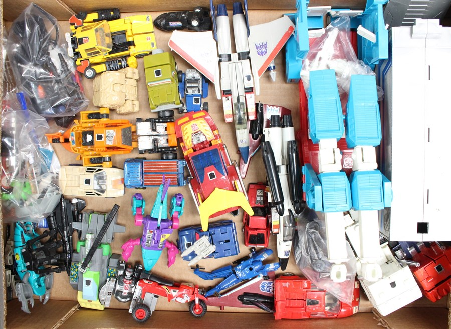 Transformers: A collection of assorted unboxed Transformers figures and vehicles to include examples
