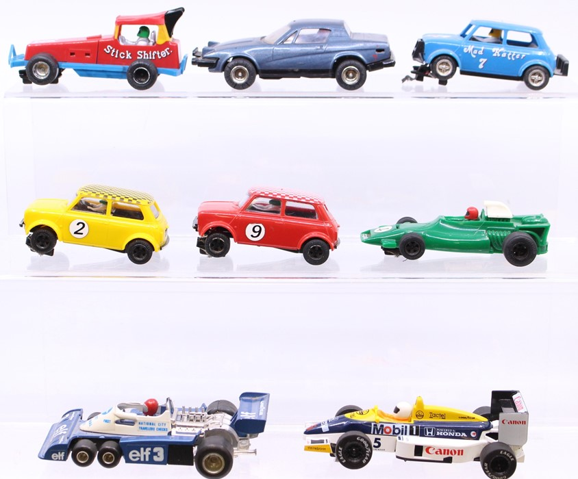 Scalextric: A collection of assorted unboxed Scalextric to include: C051 BRM; Mad Hatter Mini; TR7