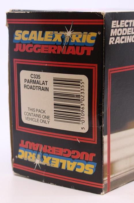 Scalextric: A boxed Scalextric, Juggernaut Roadtrain, C335 Parmalat Roadtrain, in original box, - Image 4 of 4