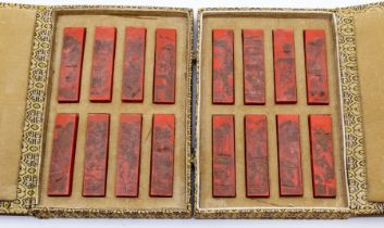A set of sixteen Chinese cinnabar coloured ink sticks,each moulded in relief showing agricultural