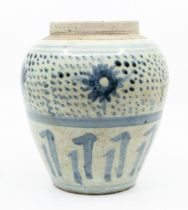 A Chineseblue one white provincial ovoid jar, painted with a band of flowers above lappets, 15.