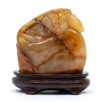 A whiteTianhaungstone,carved with a turtle to the top, the stone of a pale beige to deep amber