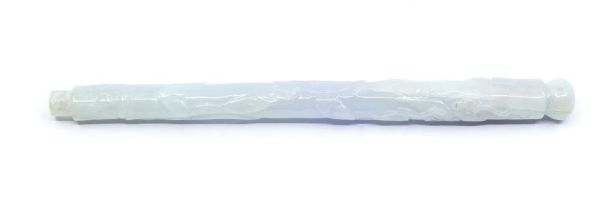 A Chinese jadeite brush handle,carved with a dragon, the stone of a pale lavender and green colour,