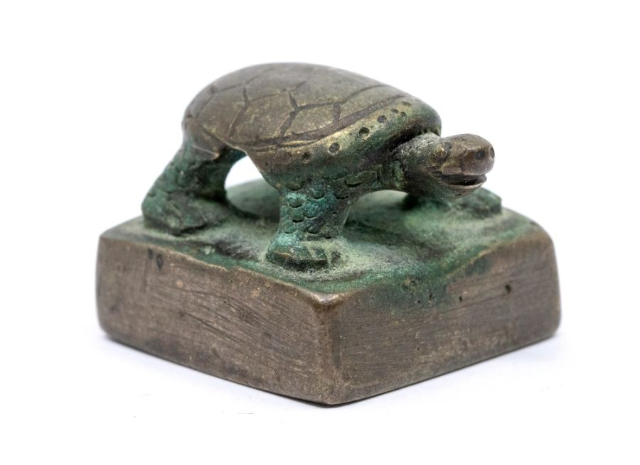 A bronze seal,cast with a tortoise standing, the seal face inscribed song mei (top of the pine