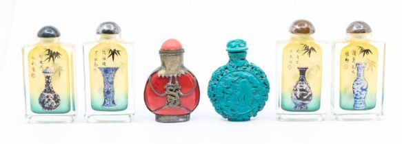 A Chinese turquoise glass snuff bottle and stopper, 20th century, moulded with figures; together