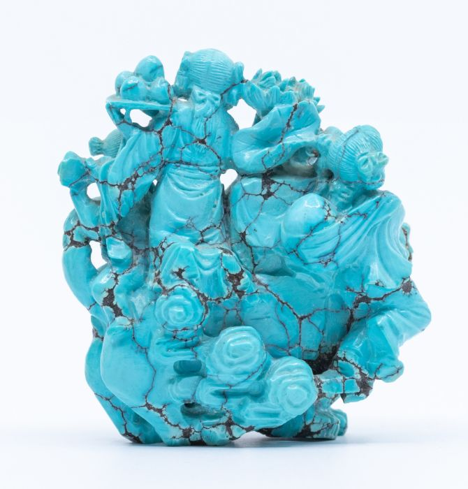 A Chinese turquoise matrix carved group,depicting four children seated on the back of a lion - Image 2 of 3