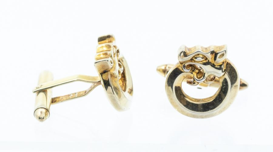 A pair of 925 silver-gilt cuff links, circular openwork design of a lion, approx 1.6cm diam, approx