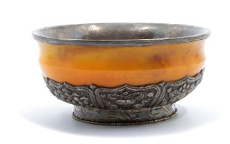 A Bhutan silver-mounted amber bowl,the base of the bowl with lappets decorated in repoussé with the