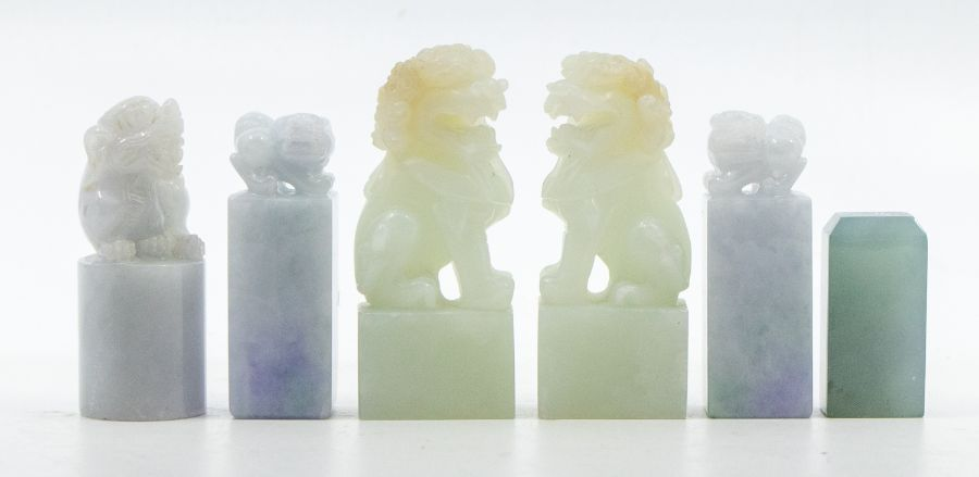 Six jade seals,comprising a pair of pale lavender and green jadeite seals, each carved with a