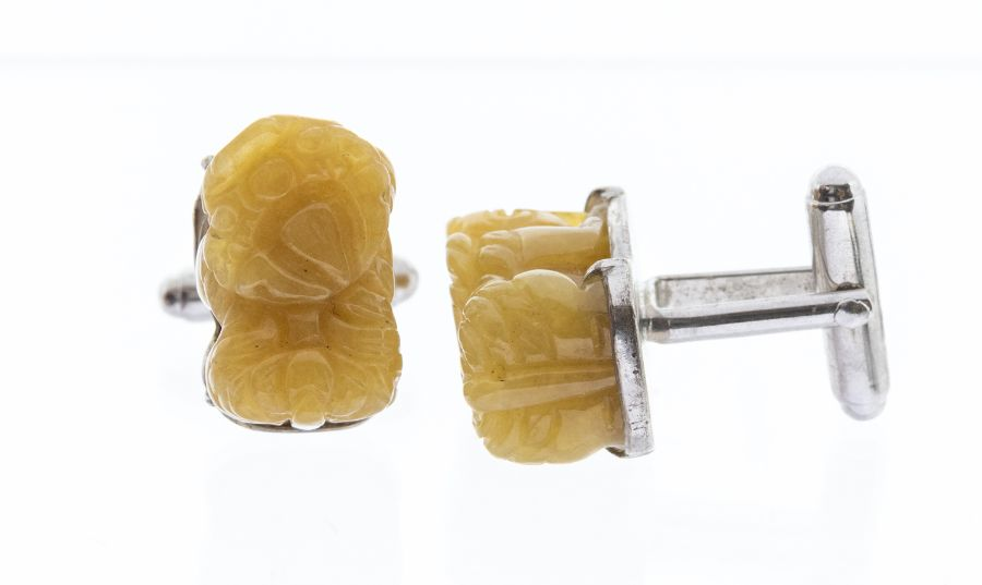 A pair of yellow jadeite stones carved as Buddhistic lions, mounted in 925 silver cufflinks, approx
