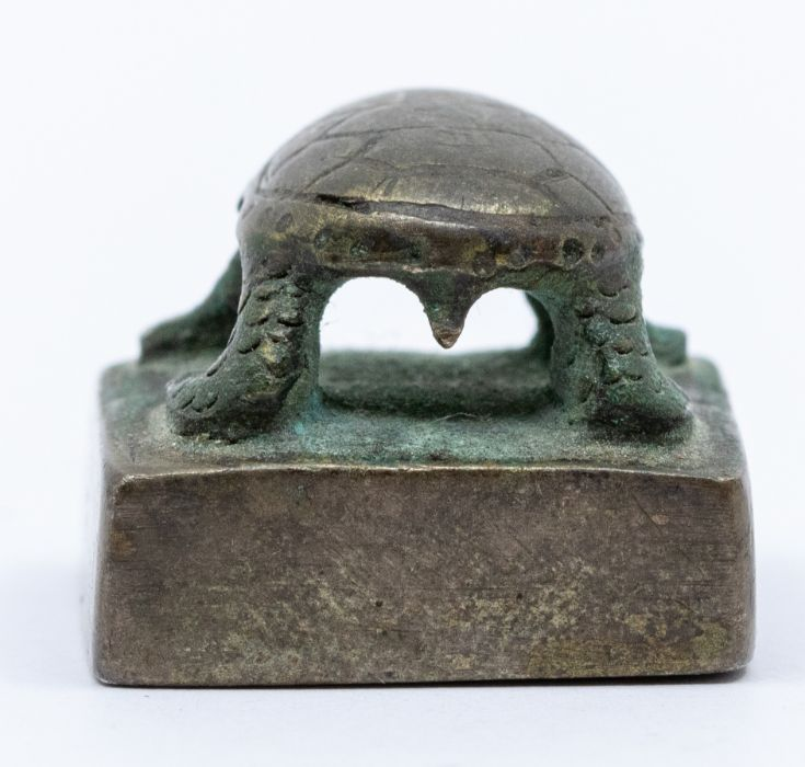 A bronze seal,cast with a tortoise standing, the seal face inscribed song mei (top of the pine - Image 4 of 4