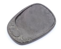A Chinese carved duan ink stone,of oval form the top carved with a double gourd amongst cloud