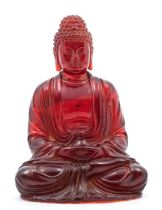 A Chinese moulded amberine figure of Buddha,the figure seated in dhyanasana, with his hands in