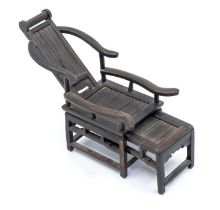 A Chinese zitan wood miniature reclining chair and foot stool,carved with the foot stool sliding